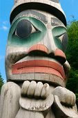 foto of tlingit  - Alaska totem pole face painted on weathered wood - JPG