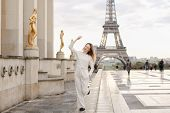 Young Female Person Walking On Trocadero Square Near Gilded Statues And Eiffel Tower In Paris. Conce poster