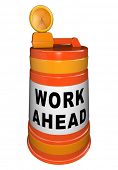 Work Ahead words on an orange traffic barrel signaling that a construction project is just down the