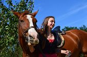 Girl leading horse pic.