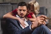 Seductive Young Woman Hugging Boyfriend In Suit Smoking Cigar poster