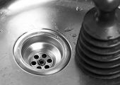 Plunger In The Sink. A Tool For Cleaning Clogs In Sinks. Close Up poster