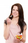 happy beautiful young woman eating salad