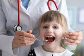 Portrait Of Joyful Little Girl Visiting Dentist And Looking At Camera With Joyfulness. Doctor In Whi poster