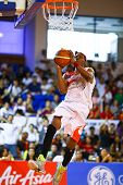 KUALA LUMPUR - JUNE 02: Tiras Wade of the Malaysia Dragons attempts a lay-up in a playoff match agai
