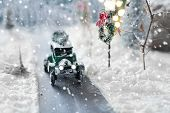 Miniature Classic Car Carrying A Christmas Tree On Snowy Road On Winter Background poster