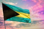 Fluttering Bahamas Flag On Colorful Cloudy Sky Background. Bahamas Prospering Concept. poster