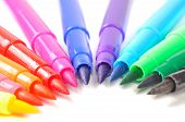 stock photo of sharpie  - Multicolored felt tip pens on a white background with copy space