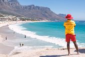 Cape Town Lifeguard Watching Famous Camps Bay Beach With Turquoise Water poster
