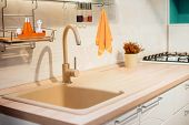 Designed Kitchen Beige Modern Faucet & Creamy Sink In Countertop. Beige Design Of Kitchen Countertop poster