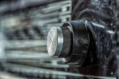 Vintage Radio Tuning Knob Close-up . Blurred Background. Small Focusing Area, Selective Focus. poster