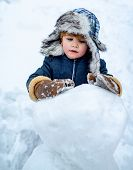 Excited Kid Winter Portrait. Kids Emotion. Winter Clothes For Kids. Joyful Kid Having Fun With Snowm poster