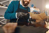 Shoemaker sharpens the shoe sole, footwear repair poster