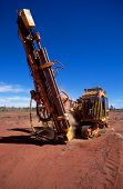 picture of gold mine  - A mobile drilling rig drilling core samples on a gold mining lease - JPG