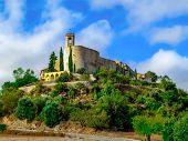 Catalan Settlement Montfalco Murallat On A Hilltop. Ancient Spanish Fortress Village, Tourist Attrac poster