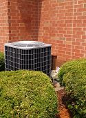 stock photo of air conditioning  - outside residential air conditioning unit by a building - JPG