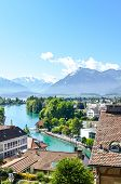 Cityscape Of The Historical City Thun In Switzerland. The Historical Old Town Located By Turquoise A poster