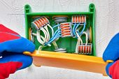 Connecting Electrical Wires With A Clamp Connector. Splicing Cables Inside The Distribution Box Usin poster