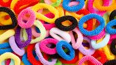 Background From Multi-colored Soft Elastic Bands For Hair. Elastic Bands For Hair Close-up. poster