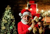 Santa Claus Holds Plush Toy. Happy Santa Claus Hugs Teddy Bear. Bearded Man In Santa Claus Costume.  poster