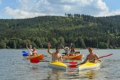 foto of kayak  - Young kayaking friends having fun in scenic view summer holiday - JPG