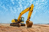 stock photo of construction machine  - excavator loader machine during earthmoving works outdoors - JPG