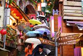 JIUFEN, TAIWAN - JANUARY 17: Tourists walk down famed steps January 17, 2013 in Taipei, TW. A gold m