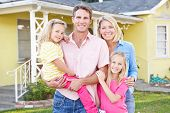 image of mums  - Family Standing Outside Suburban Home - JPG