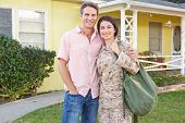stock photo of army  - Husband Welcoming Wife Home On Army Leave - JPG