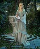 stock photo of fairyland  - an elven princess with a silver carafe in their hands - JPG
