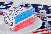 stock photo of sprinkling  - Red white and blue layer cake with sprinkles