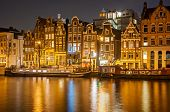stock photo of houseboats  - Amsterdam at night - JPG