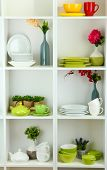 image of armoire  - Beautiful white shelves with tableware and decor - JPG