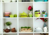 pic of armoire  - Beautiful white shelves with tableware and decor - JPG