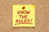 stock photo of moral  - Know The Rules written on yellow sticky note with red marker - JPG