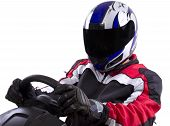 picture of armor suit  - Racer in a tinted helmet and red racing suit - JPG