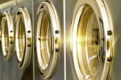 picture of laundromat  - A noble public laundromat with golden shine - JPG