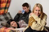 Young friends spend winter holiday in cozy cottage wear warm jumpers
