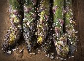 Grilled Purple Asparagus On Wood In Closeup
