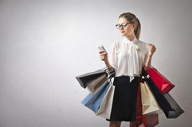 stock photo of going out business sale  - beautiful young woman goes shopping - JPG