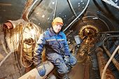 pic of tunnel  - Tunneller sinker worker connecting equipment in tunnel of sewer collector at undergroung working - JPG