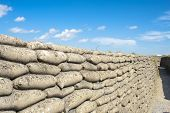 stock photo of sandbag  - trench world war sandbags and blue sky - JPG
