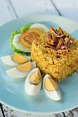 stock photo of crispy rice  - thai curry fried rice with crispy fish and boiled eggs - JPG