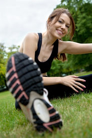 pic of workout-women  - woman doing stretching exercises on the floor outdoors - JPG