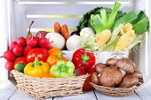 pic of wooden crate  - Vegetables in crate and in baskets on white wooden box background - JPG