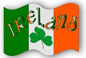 stock photo of irish flag  - The Republic of Ireland flag with the text IRELAND and a lucky shamrock a symbol of the Irish people - JPG