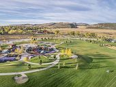 image of collins  - aerial view of park and playground at foothills of Rocky Mountains in Fort Collins - JPG