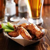pic of chicken wings  - buffalo chicken wings in disposable tray with celery and ranch - JPG