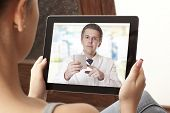 pic of video chat  - Woman having video chat with doctor on laptop at home - JPG