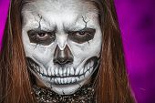 picture of day dead skull  - Young woman in day of the dead mask skull face art - JPG